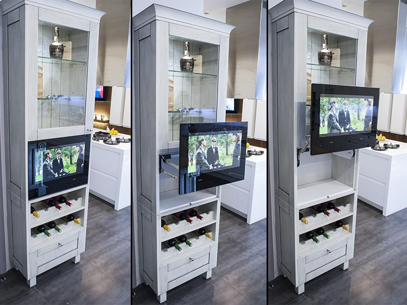 Встроенный телевизор на кухне в двери шкафа